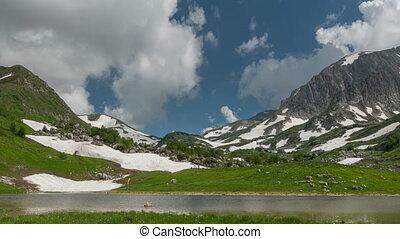 Lake Psenodakh among the high mountains. Timelapse....