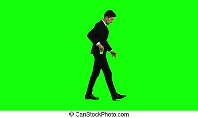Man goes to work and talks on the phone. Green screen. Side...