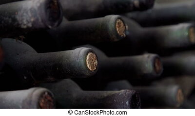 Old Bottles of wine in traditional wine cellar - Bottles of...