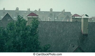 Sloping roofs of town houses in the rain. Slow motion shot