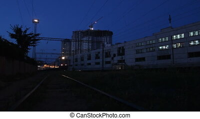Night passenger train leaving railway station time lapse...