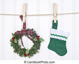 Holiday Concept with Holly Berry Wreath and Stocking Hanging...