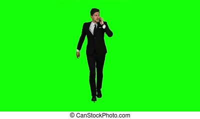 Guy rushes to him the phone rings, he starts talking and running. Green screen