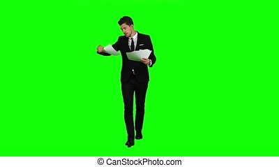 Businessman holds the documents in his hands and throws it...