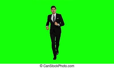 Man is a telephone rings to him and he talks. Green screen -...
