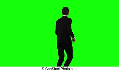 Man is in a hurry to work, he starts to run. Green Screen