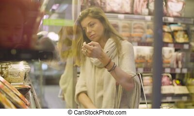 Young attractive woman in a supermarket - A young woman...