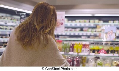Young attractive woman in a supermarket - Young attractive...