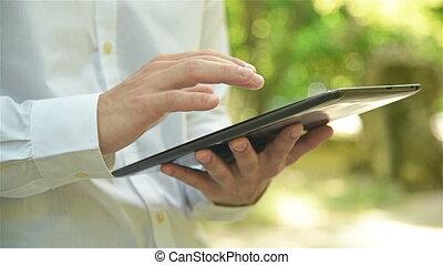 Hipster Using Digital Tablet - Hipster Man Using Digital...