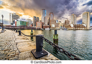 Boston, Massachusetts, USA city skyline at the harbor.