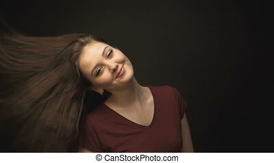 Beautiful brunette woman shaking head
