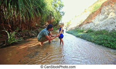 Father Small Daughter Wash Hands in Fairy Stream and Talk