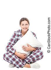 Woman sitting on the floor hugging soft pillow against white...