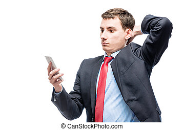 Portrait of a surprised businessman with a phone in his hand on a white background
