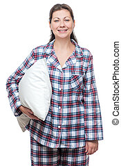 Smiling young woman in pajama with pillow posing on white...