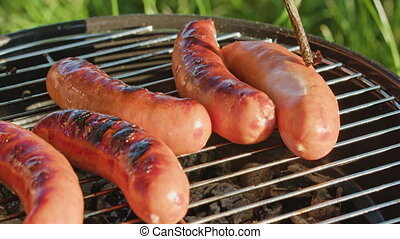 Barbecue Grill. Grilling Sausages
