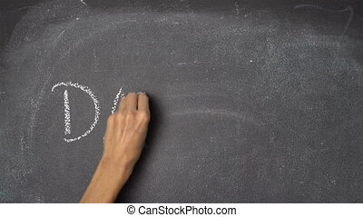 "Hand writing ""DAY 1, 2 & 3"" on black chalkboard - Woman's..."