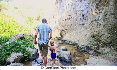 Dad Takes Small Daughter Hand Walk in Narrow Stream - Father...