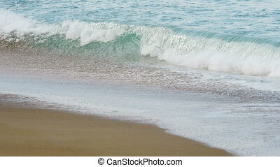 Waves on a sandy beach. May Khao beach in the north of...