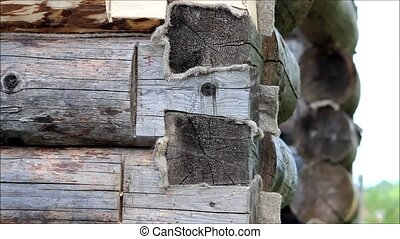 Worker checks the level with a vertical on a wooden log door...