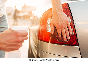 Tail lights polishing on car wash station - Tail lights...