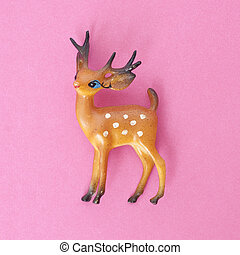 Vintage Deer Holiday Toy on a Vibrant Pink Background