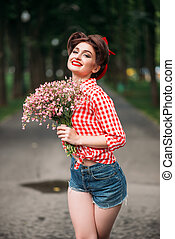 Pinup girl with bouquet of flowers, retro fashion - Pinup...