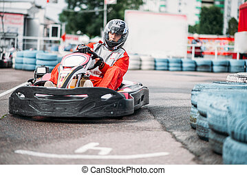 Karting racer in action, go kart competition on outdoor...
