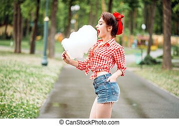 Sexy pinup girl with sweet cotton candy on stick, retro...