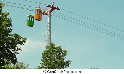 cableway in summer park on the sky background