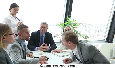Business people shaking hands, finishing up a meeting,...