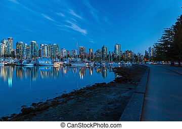 Vancouver BC Skyline along Stanley Park Seawall - Vancouver...