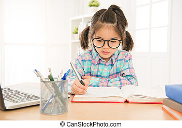 pretty girl kid wear glasses seriously writing - pretty cute...