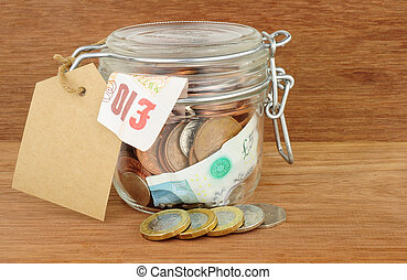 Glass Jar Filled With Cash - Glass jar filled with cash...