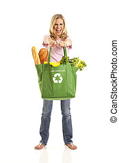 Young woman with groceries in recycle bag