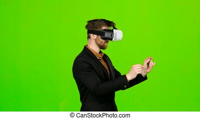 Businessman in glasses of virtual reality, typing text....