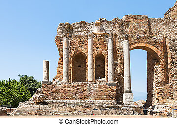 wall and columns of Teatro Greco in Taormina - travel to...