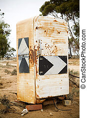 Country road signs plastered onto an old fridge