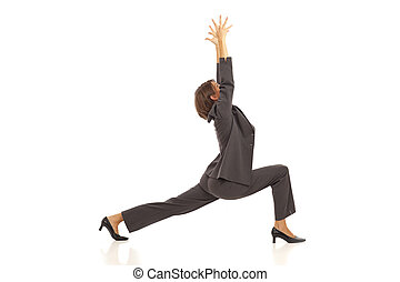 Businesswoman doing yoga - Young businesswoman in suit doing...