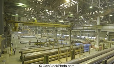 Yellow Indoor Crane. Work hanging of a crane at the plant...