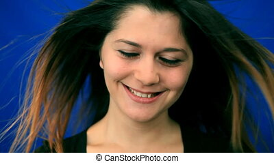 Pretty young woman smiling in wind