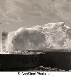 Big wave spash - Big stormy sea wave splash. Pier and beacon...