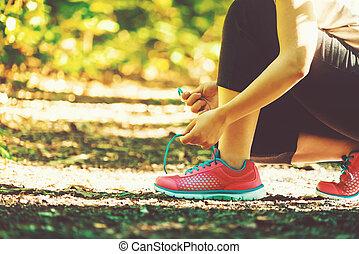Female runner preparing to jog - Female runner preparing to...