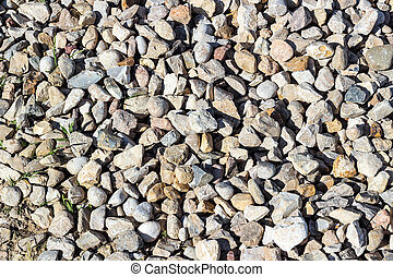 Background pattern, Crushed stone and small stones filled with sun
