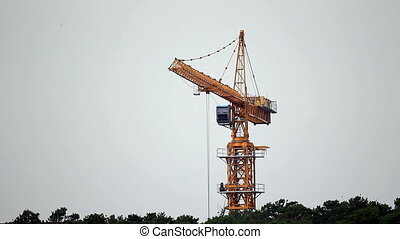 Construction site with working tower crane