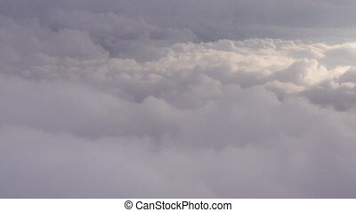 View of clouds from the airplane window