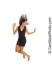 Young excited woman jumping - Cute young girl with black...