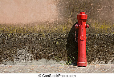 Fire faucet, standing at a wall