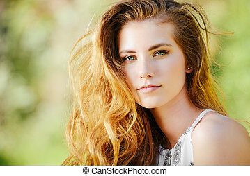 redhaired young woman - Attractive young woman with...