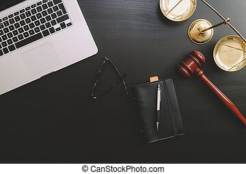 justice and law concept.Lawyer workplace with laptop and documents with dark wooden